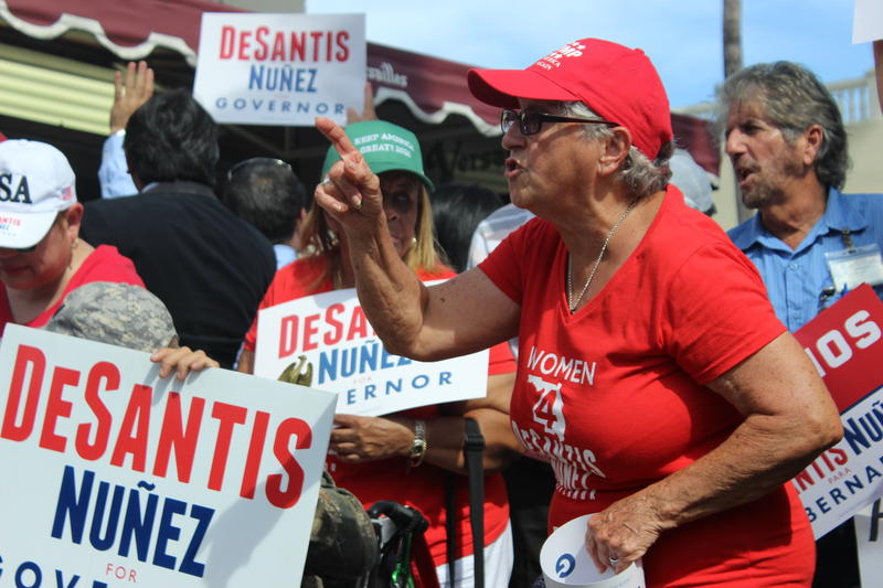 Nearly a hundred supporters of Republican gubernatorial candidate Ron DeSantis gathered outside Versailles Cuban Bakery on Thursday, Nov. 1, 2018.