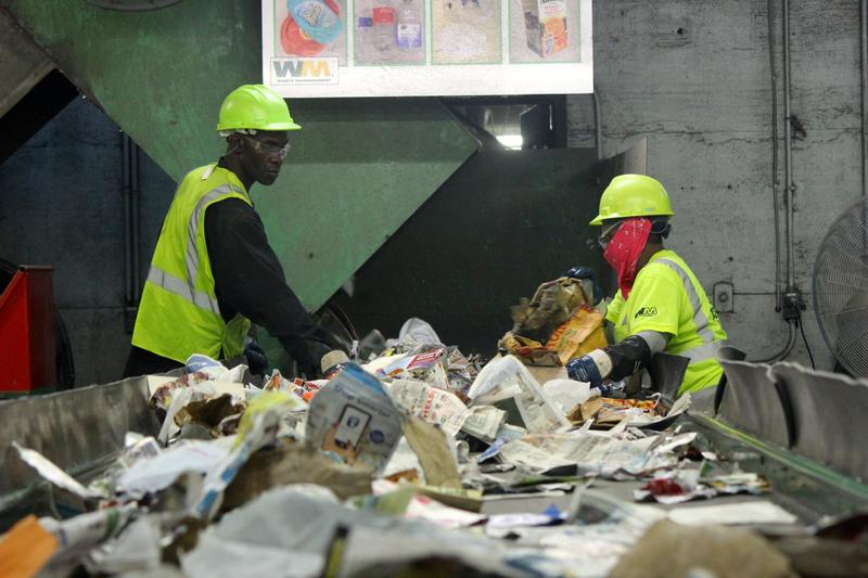 Sorters at Reuters Recycling Facility try to discard non-recyclable items.