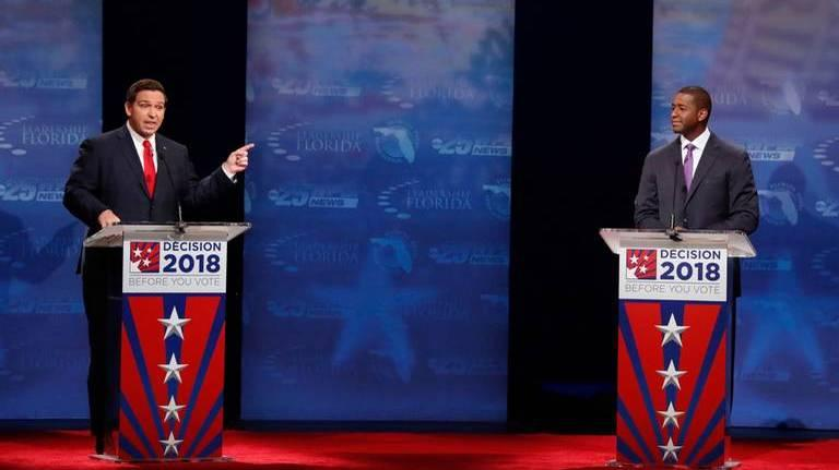 Republican Ron DeSantis (left) hopes to keep his margin of victory outside the 0.5 percent that would force a recount and give life to Democrat Andrew Gillum.