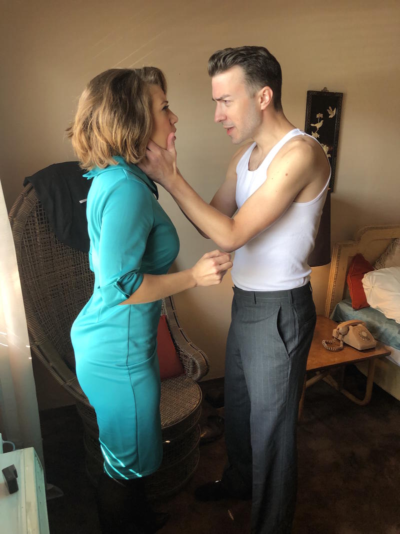 An actress plays a Playboy Bunny confronting a detective in their motel room at Miami Motel Stories.