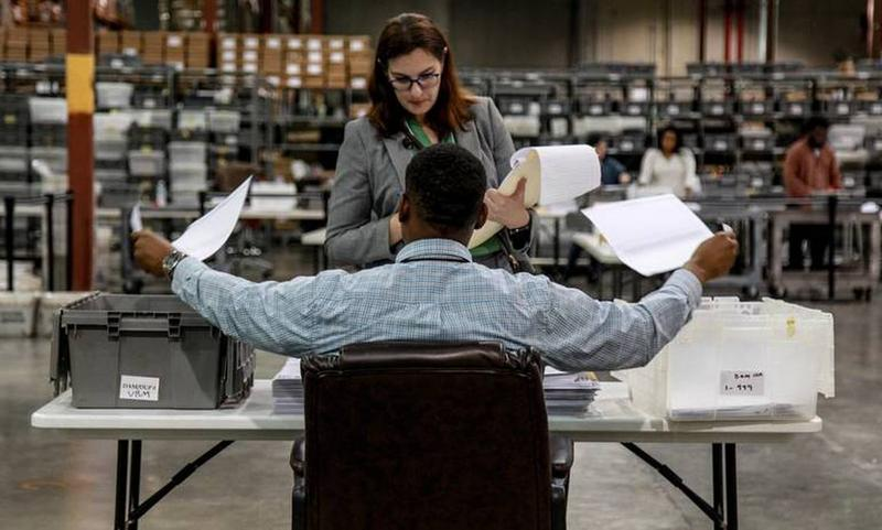 A scene from the recount in Palm Beach County. With the 2018 elections behind us, the Legislature is considering how to make things go more smoothly in the future.