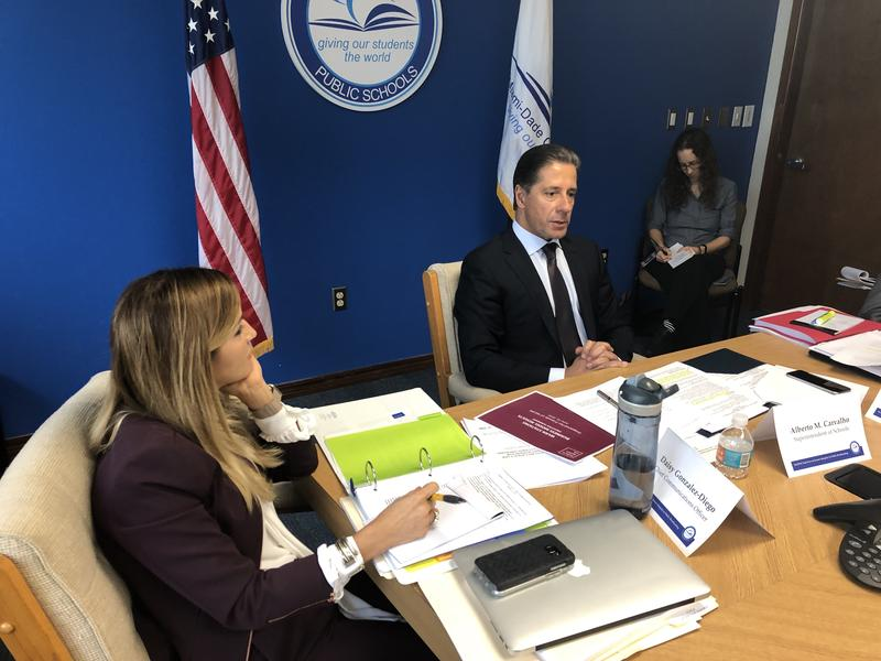 Miami-Dade County schools superintendent Alberto Carvalho (center) and the school district's chief communications officer, Daisy Gonzalez-Diego (left), attend the final meeting of a task force considering the future of WLRN.