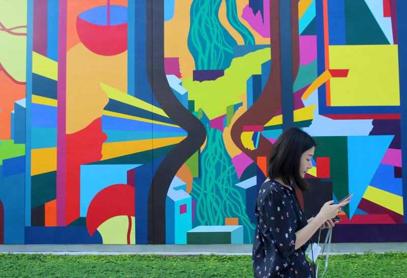Hundreds showed up for the official ribbon-cutting ceremony of the newly renovated Miami Beach Convention Center and debut of the center's first public art mural, called 'About Sand,' on Tuesday, December 4, 2018.