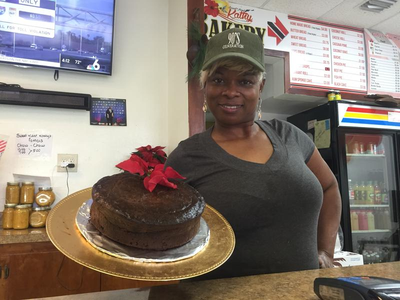 Kathy Ann Paul shows off one of her first Christmas black cakes of the season at her Trinidadian restaurant-bakery Sweet Hand Kathy in Miami Gardens.