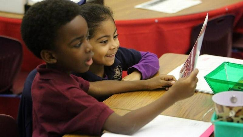 Kindergarten students Gregory Antoine and Kaylee Monteagudo at AIE Charter School in Miami Springs. Charter schools in Miami-Dade want to share in money from a recently approved tax increase.
