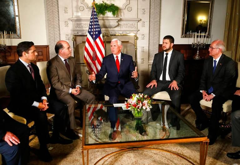 U.S. Vice President Mike Pence, center, speaks with Venezuelan opposition leaders, from left, Carlos Vecchio, Julio Borges, David Smolansky and Antonio Ledezma during a meeting at the residence of the U.S. ambassador in Lima, Peru, in April 2018.