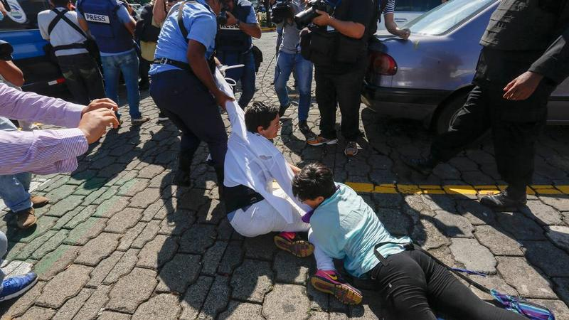 Nicaraguan police arrest anti-government protesters during a recent demonstration in Managua.