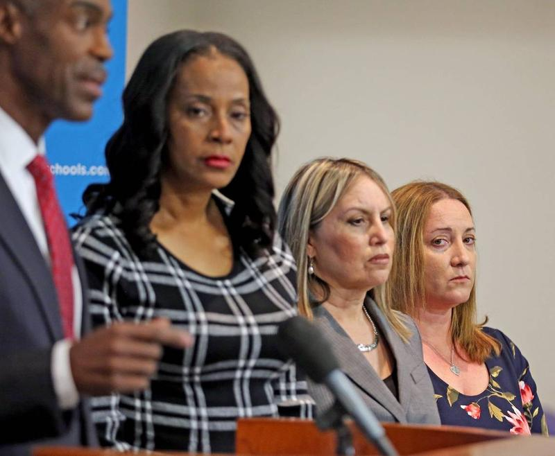 Broward County Public Schools Superintendent Robert Runcie outlines changes he has implemented in the district since last year's deadly shooting. School board members stand beside him, including Lori Alhadeff (far right), whose daughter Alyssa was killed.