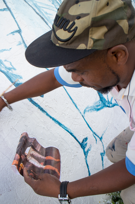 Serge Toussaint paints a mural tribute in Little Haiti to Haitian freedom fighters.