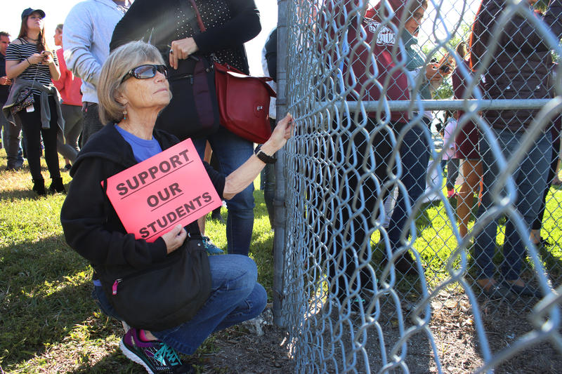 "Stephanie Leaf supports students from Marjory Stoneman Douglas High School from outside of the school during the March 14 walkout. ""There is no place I'd rathe be,"" she said."