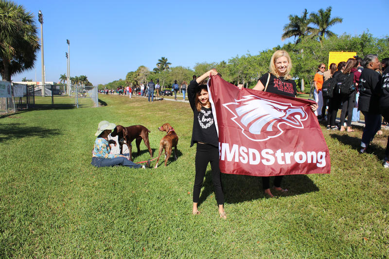 Addison Freed, left, and her mother and alumna of the high school, Melissa Freed, right, support the students protesting at Stoneman Douglas on March 14, 2018.