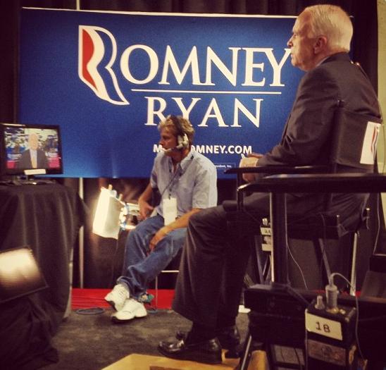 Sen. John McCain takes interviews in the debate press room.
