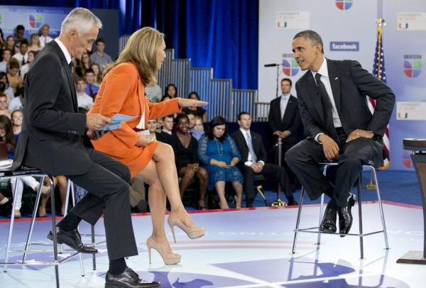 Hosts Jorge Ramos (left) and Maria Elena Salinas (center) sit with President Obama at the University of Miami September 20, 2012 in Coral Gables.