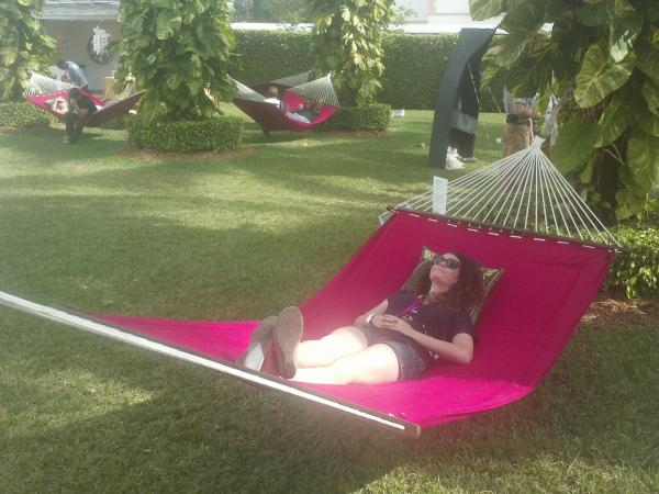 The Art Of Repose: WLRN's Arianna Prothero discovers the red hammocks at Pulse Art Fair on N. Miami Avenue.