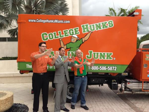 From left to right, Christopher Poore Miami franchise co-owner, Omar Soliman College Hunks Co-founder and CEO, Ron Rick, Miami franchise co-owner.