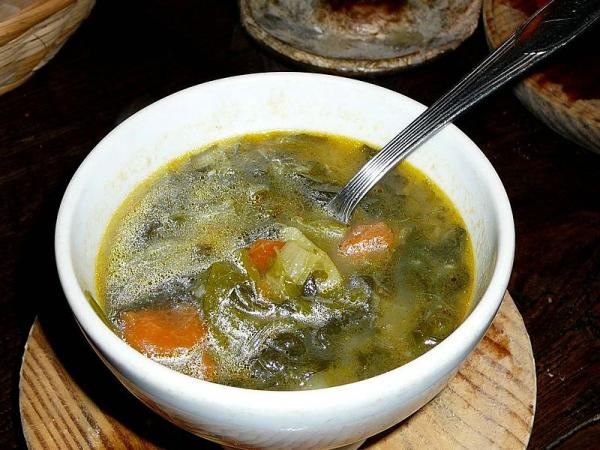 Caldo Gallego is a white bean soup made with pork, potatoes, collard greens, boniato and garlic.