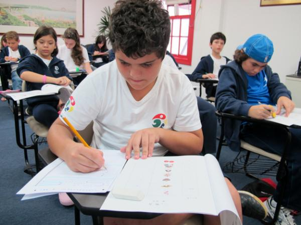 School children in Sao Paolo, Brazil take a Mandarin-language proficiency class at the Confucius Institute, which offers language courses and Chinese cultural programs.