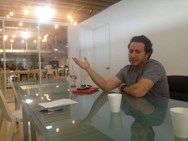Bookigee's COO Glen Surnamer explains the company's business model at The LAB Miami in Wynwood.