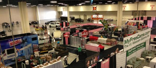 WHAT YOU CAME FOR: A survey of Exxxotica's offerings: cars on the lert, sex on the right.