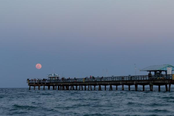 SUPERMOON Photographer John Spade got this shot of the last supermoon on May 5, 2012. It shines on an Atlantic Ocean pier north of Fort Lauderdale.