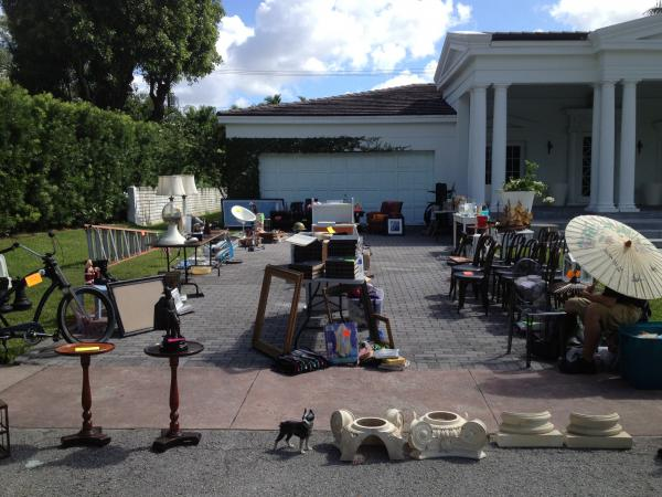 Garage sales like this on North Greenway Drive must comply with the city's strict regulations.