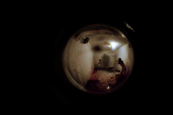 Peephole view of Antonia Wright and Ruben Millares' performance, Drinks on Me at Spinello Projects.