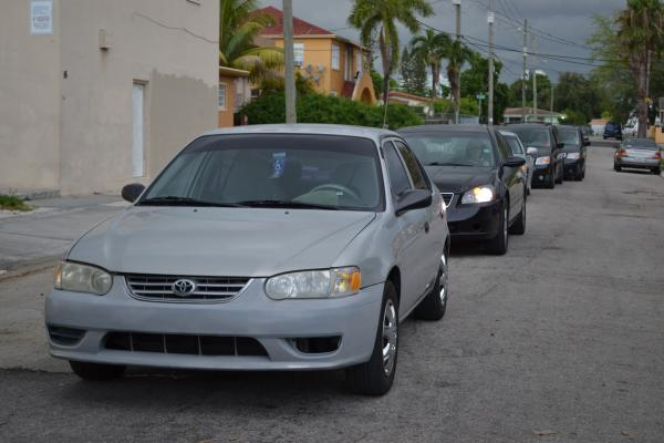 A long wait at Flagler Street and 18th Avenue caused some drivers to get out of their cars.