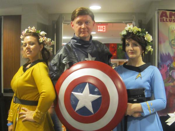"Paying homage to the original ""Star Trek"" series, Corinne Martin dresses as Captain Kirk and Ruby Mountfort dresses as Bones. Brian Sinclair dresses as Captain America from Marvel Comics."