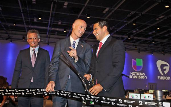Doral Mayor Luigi Boria (left) Florida Gov. Rick Scott (middle) and Univision President Cesar Conde (right) take their positions at the ribbon cutting of Fusion, the new ABC/Univision joint venture on August 26.