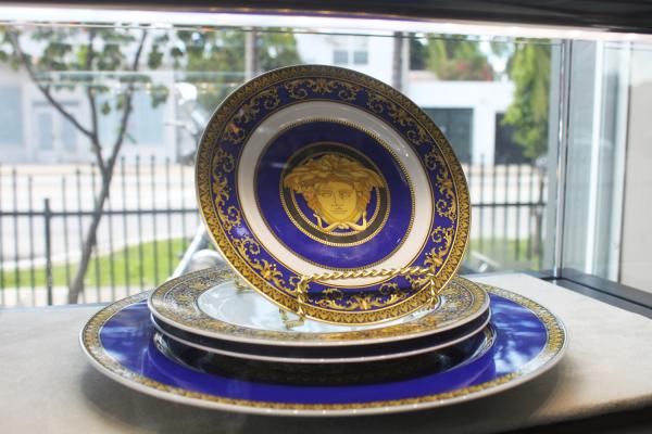 These Versace plates have a retail price of $2,600. At Midtown Pawn Boutique they are $1,650.
