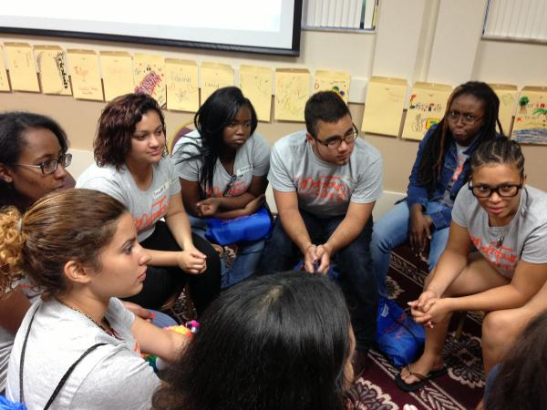 Students hold a debrief and discussion after every activity at MetroTown.