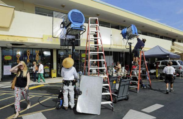 "In this July 24, 2013 photo, film crews prepare the set for rehearsal and taping of an episode of ""Burn Notice"" in Miami. The cable spy drama is coming to an end after seven seasons with a big finale today."