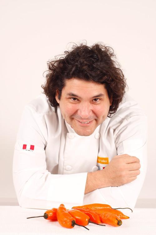 Peruvian chef Gaston Acurio with aji amarillo, or yellow chiles.