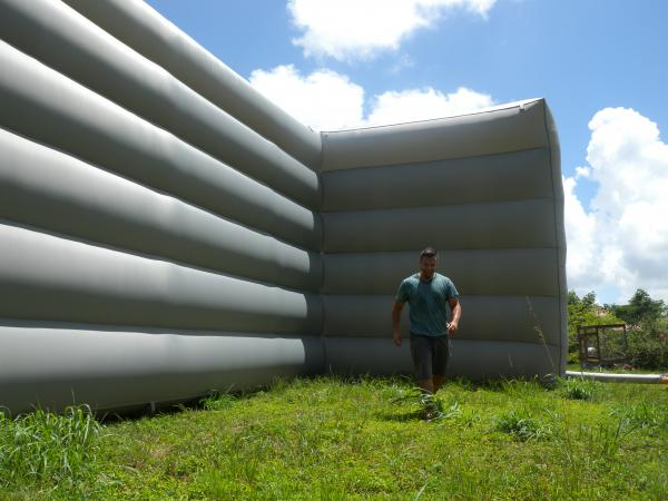 Artist Yamel Molerio stands in front of one of the large structures from the exhibition Giants in the City.