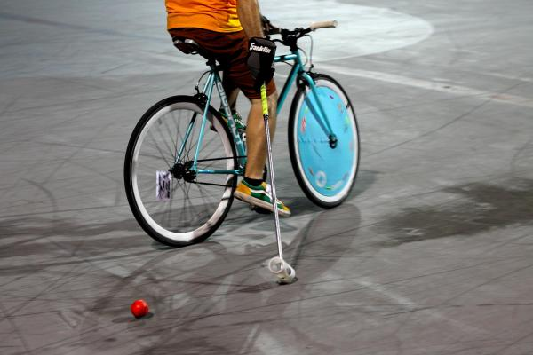 FTL Bike Polo player with handmade wheel cover and mallet at Holiday Park in Fort Lauderdale.