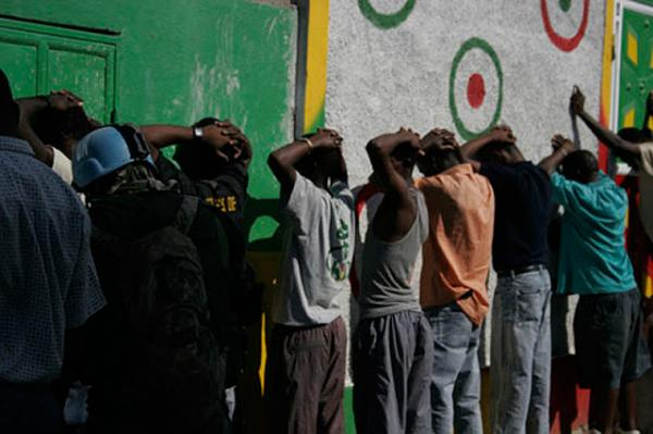 Kingston gang members being rounded up by Jamaican police.