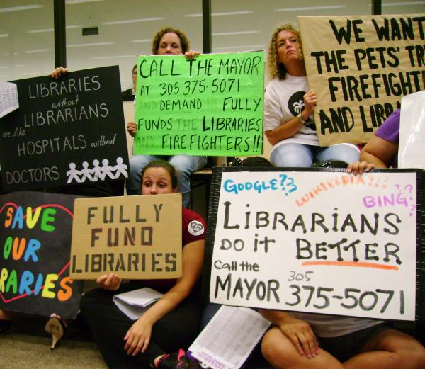 Librarians and their supporters dogged Mayor Gimenez, budget meeting after budget meeting.