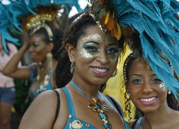 Dana Matthews (left) and Tarakaye Clunis, participated in Miami Broward One Carnival in Miami Gardens in 2011. This week's parade is Sunday.