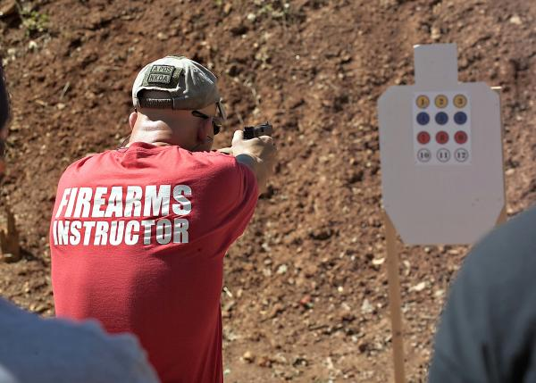 Paul Wages, a senior firearms instructor at Defensive Solutions in Powell, Tennessee, shoots a target at a local gun range.