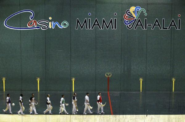 Jai-Alai players prepare to play a game at the once cultural icon in Miami, Aug. 22, 2013. The Jai-Alai fronton declared bankruptcy earlier this year. Despite the financial restructuring they will continue to entertain with Jai-Alai, concerts, and gambling.