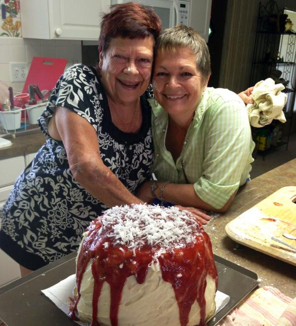 Joanie Griffin, owner of the historic Tamiami Trail restaurant, Joanie's Blue Crab, is all smiles with her daughter Terri Rementeria. The pair took first place in a recent guava coconut cake contest in Everglades City.