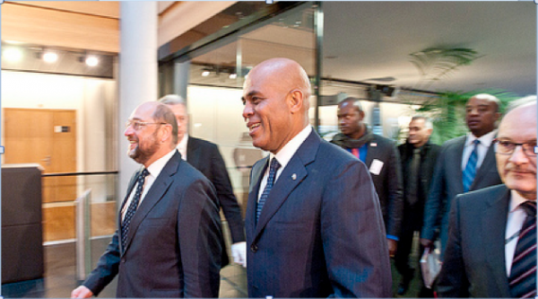 Monday was a national holiday marking Haiti's fight for independence, but many marked the day by protesting against corruption and delays in legislative and local elections under Haitian President Michel Martelly (center).