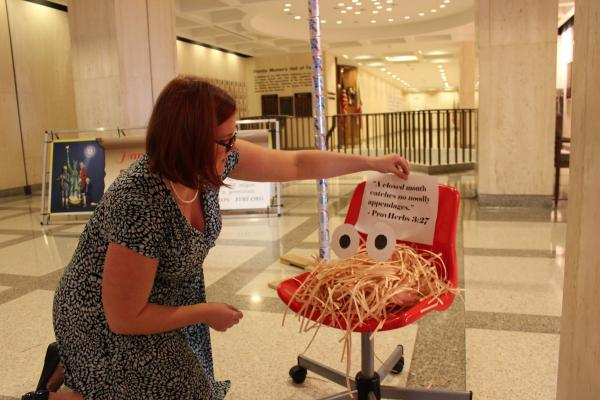 A Flying Spaghetti Monster sits in front of the Florida Capitol's Festivus pole.