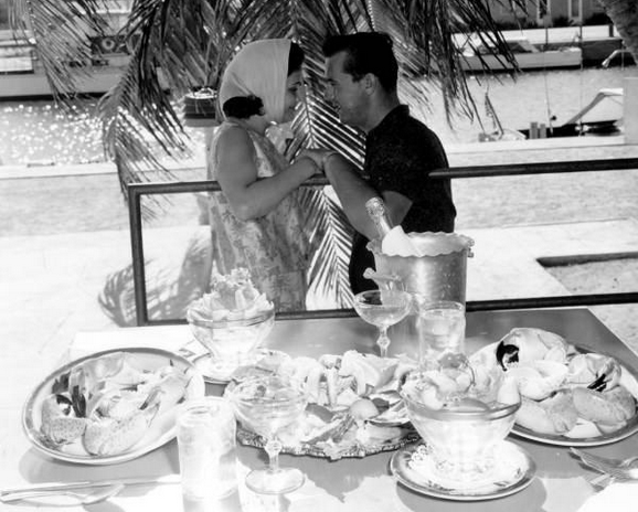 A couple chats after ordering stone crab in Key West, 1963.