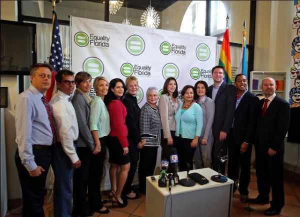 Above, the six couples and their attorneys at a press conference announcing the lawsuit challenging the state's same sex marriage ban.
