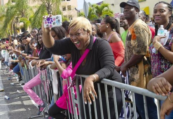 Carla Horne, a teacher at Miami Jackson Senior High, waves at some of her students as they march in honor at the 2013 Martin Luther King Jr. parade in Liberty City.