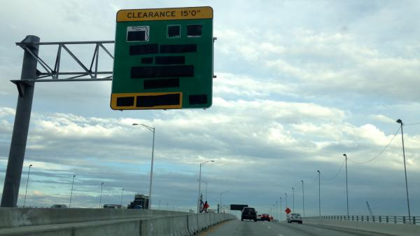 Over the MacArthur Causeway looms one of many redacted signs popping up on 395 and I-95.