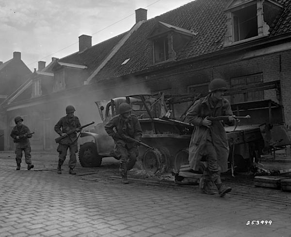 In Holland, American paratroopers turned infantrymen advance during Operation Market Garden. September 25, 1944.