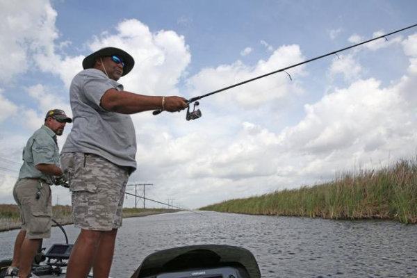 Neal Stark and Rudy Watt, right, enjoy a fishing trip in Sawgrass Park fishing for large mouth Bass, Tuesday, April 9, 2014.