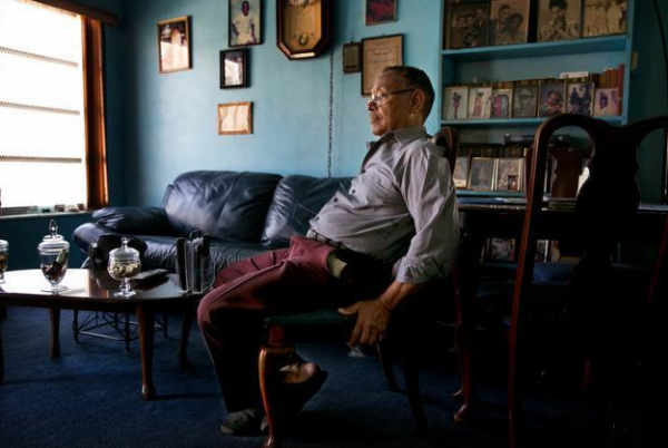 Benjamin Brown, 80, sits in the living room of his family home a week before movers arrived to pack his belongings and move him out. Brown's last day in his home was April 28.